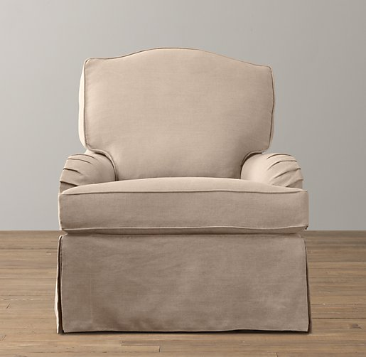 Camelback slipcovered swivel glider