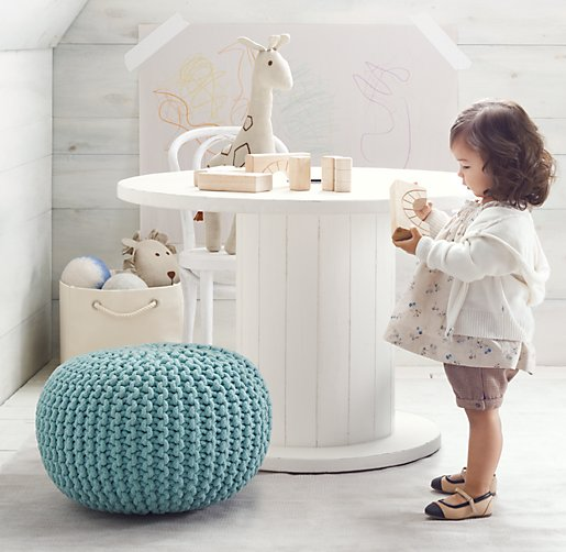 white wire spool used as a table in little girl room with blue puff
